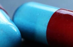 Closeup of red and blue prescription capsules