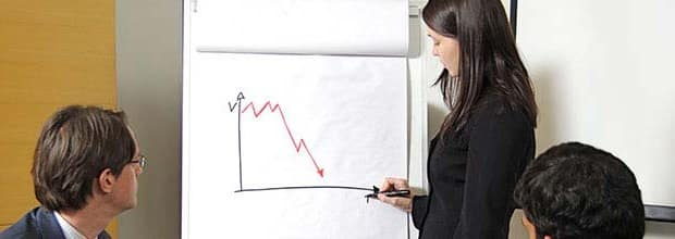 A business woman sharing a troubling chart with colleagues